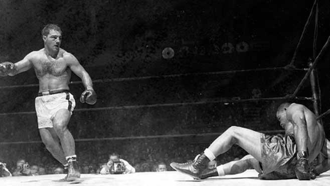 Rocky Marciano derriba a Joe Louis