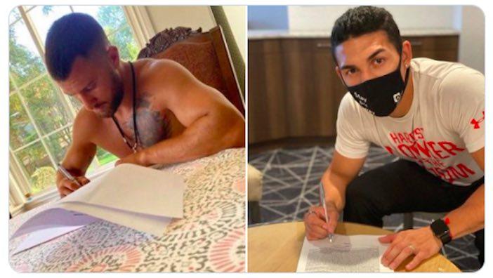 Lomachenko y López firmando
